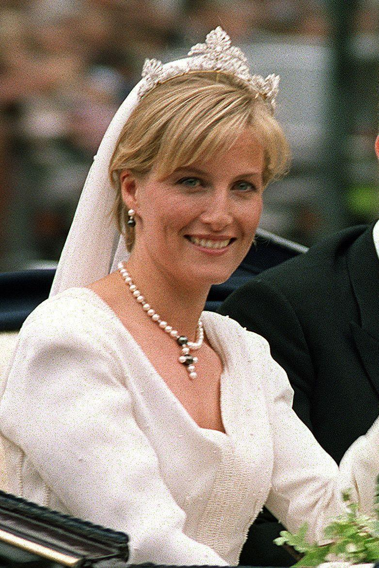 "<p><strong>Wedding date: </strong>June 19, 1999</p><p><strong>Wedding tiara:</strong> Sophie married <a href=""https://www.townandcountrymag.com/society/tradition/a12808670/prince-edward-facts/"" rel=""nofollow noopener"" target=""_blank"" data-ylk=""slk:Prince Edward, Queen Elizabeth's youngest son,"" class=""link rapid-noclick-resp"">Prince Edward, Queen Elizabeth's youngest son,</a> in an intimate royal wedding <a href=""https://www.townandcountrymag.com/society/tradition/g15881437/royal-weddings-history-windsor-castle-st-georges-chapel/"" rel=""nofollow noopener"" target=""_blank"" data-ylk=""slk:at Windsor Castle"" class=""link rapid-noclick-resp"">at Windsor Castle</a> in 1999. Sophie's diamond tiara was a gift from the Queen. It was remodeled for Sophie by the crown jeweler, and was created out of four pieces of a crown that once belonged to Queen Victoria, <a href=""https://www.theknot.com/content/royal-wedding-tiaras-princess"" rel=""nofollow noopener"" target=""_blank"" data-ylk=""slk:according to the Knot."" class=""link rapid-noclick-resp"">according to the <em>Knot</em>.</a></p>"