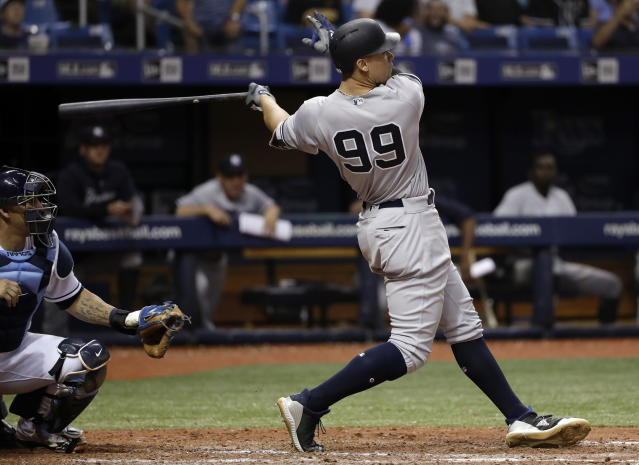 New York Yankees' Aaron Judge follows his RBI-single off Tampa Bay Rays pitcher Chaz Roe during the seventh inning of a baseball game Friday, June 22, 2018, in St. Petersburg, Fla. Yankees' Gleyber Torres scored. (AP Photo/Chris O'Meara)