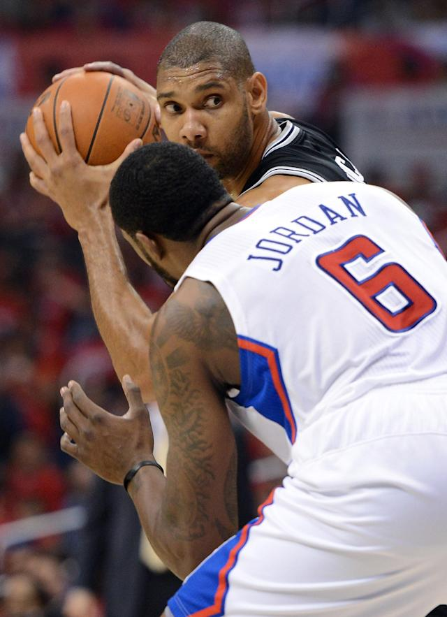 LOS ANGELES, CA - MAY 20: Tim Duncan #21 of the San Antonio Spurs looks to drive on DeAndre Jordan #6 of the Los Angeles Clippers in the first quarter in Game Four of the Western Conference Semifinals in the 2012 NBA Playoffs on May 20, 2011 at Staples Center in Los Angeles, California. NOTE TO USER: User expressly acknowledges and agrees that, by downloading and or using this photograph, User is consenting to the terms and conditions of the Getty Images License Agreement. (Photo by Harry How/Getty Images)