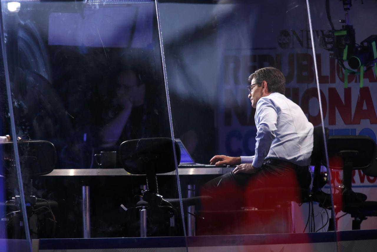 Former Clinton administration staff member and current television host and interviewer George Stephanopoulos sits in the ABC News booth over the convention floor during the Republican National Convention in Cleveland, Ohio, U.S., July 19, 2016.   REUTERS/Carlo Allegri