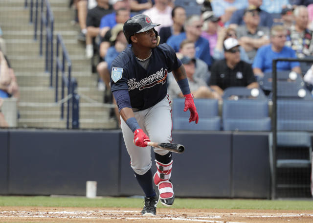 FILE - In this March 2, 2018, file photo, Atlanta Braves' Ronald Acuna watches after hitting a two run home run during the first inning of a baseball spring exhibition game against the New York Yankees in Tampa, Fla. The Braves need Acunas power and speed in their lineup if they hope to move closer to .500 following their 72 wins in 2017. (AP Photo/Lynne Sladky, File)