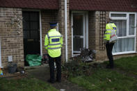 Police volunteers use large bags to collect completed COVID-19 home testing kits that residents received earlier in the day, in Woking, England, Tuesday, Feb. 2, 2021, during England's third national lockdown since the coronavirus outbreak began. British health authorities plan to test tens of thousands of people in a handful of areas of England in an attempt to stop a new variant of the coronavirus first identified in South Africa spreading in the community. The Department of Health says a small number of people in England who had not travelled abroad have tested positive for the strain. (AP Photo/Matt Dunham)