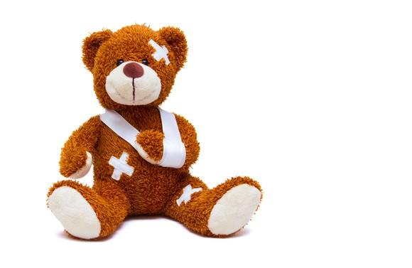 Teddy bear with bandages and a sling