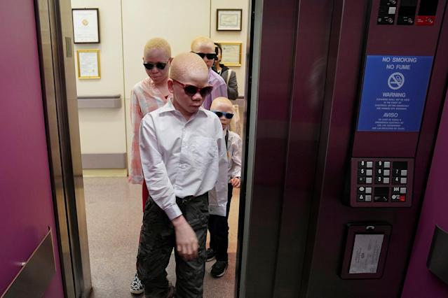 <p>Baraka Lusambo, 7, Mwigulu Magesaa 14, Emmanuel Rutema, 15, and Pendo Noni 16, Tanzanians with albinism who had body parts chopped off in witchcraft-driven attacks, arrive for prosthetic arm fittings at the Shriners Hospital in Philadelphia, Pa., on May 30, 2017. (Photo: Carlo Allegri/Reuters) </p>