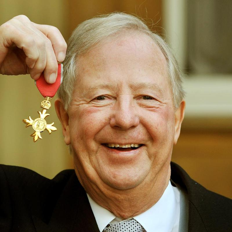 Tim Brooke-Taylor, proudly holds his OBE in 2011.