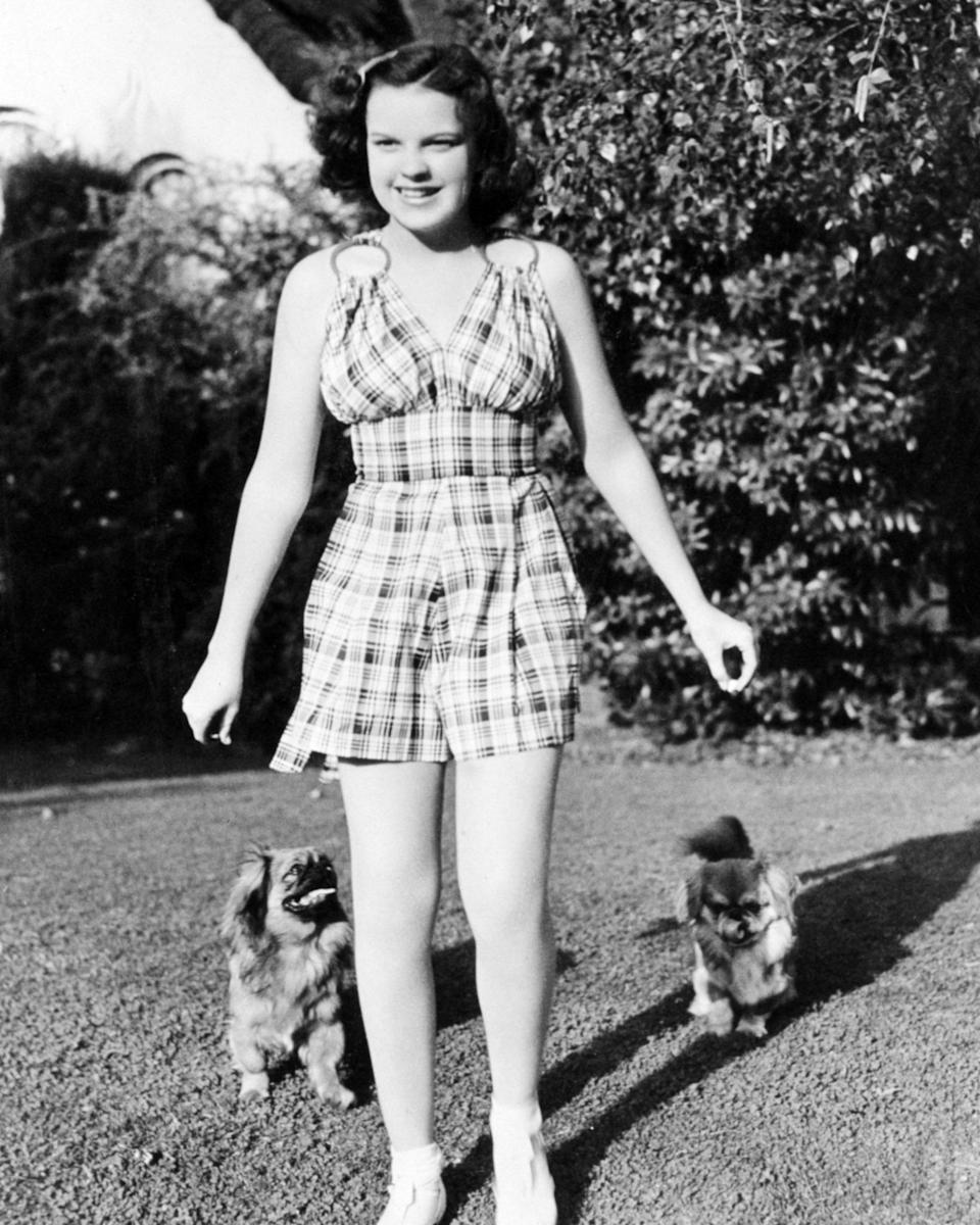 Actress and singer Judy Garland with two pet dogs, circa 1940.