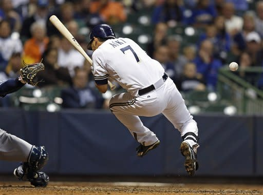 Milwaukee Brewers' Norichika Aoki is hit with a pitch by San Diego Padres' Tom Layne during the seventh inning of a baseball game Tuesday, Oct. 2, 2012, in Milwaukee. (AP Photo/Tom Lynn)