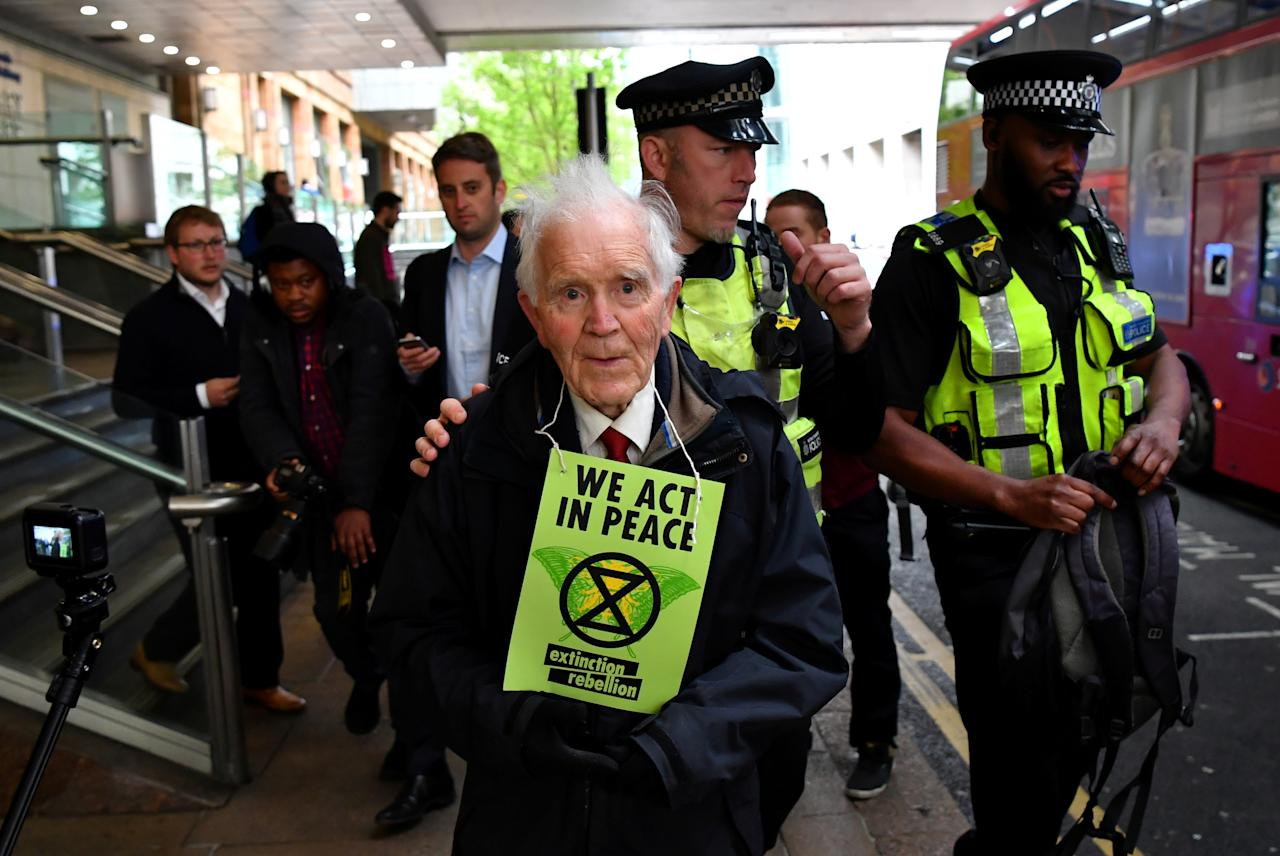 Police takes away protester Phil Kingston, 83, during a demonstration blocking traffic at Canary Wharf Station during the Extinction Rebellion protest in London, Britain April 25, 2019. REUTERS/Dylan Martinez TPX IMAGES OF THE DAY