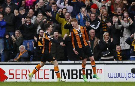 Hull City's Sam Clucas celebrates scoring their second goal with Andrew Robertson