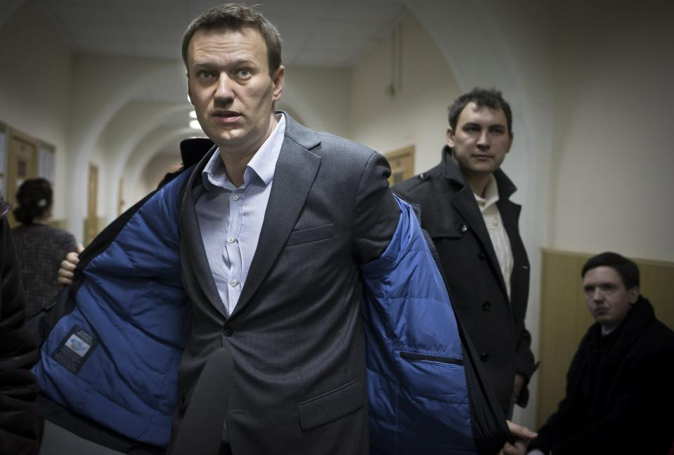 FILE - In this Wednesday, March 13, 2013 file photo, Russian opposition activist Alexei Navalny prepares to speak to journalists outside a courtroom in Moscow, after his appeal against the country's top investigative agency was rejected. Navalny had filed a complaint asking the Investigative Committee to begin proceedings against its chairman, Alexander Bastrykin, for his threat to murder a journalist in June last year. (AP Photo/Alexander Zemlianichenko, File)
