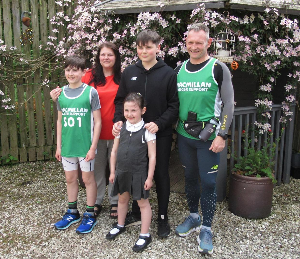 Gary McKee (right) with wife Sue and children children Alfie, 16, Beau 13, and Minnie, nine (Macmillan Cancer Support/PA)
