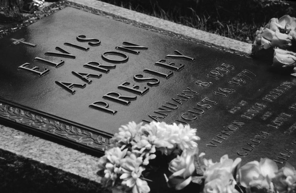 "<p>Elvis was buried in the <a href=""https://www.graceland.com/elvis-news/posts/gladys-presleys-headstone-added-to-meditation-garden"" rel=""nofollow noopener"" target=""_blank"" data-ylk=""slk:Meditation Garden"" class=""link rapid-noclick-resp"">Meditation Garden</a> on the grounds of Graceland. His mother was moved to a plot next to him and, two years later, his father joined them when he passed away. In order to preserve the gravesite, Elvis's estate must <a href=""https://www.latimes.com/archives/la-xpm-1989-06-11-tm-2866-story.html"" rel=""nofollow noopener"" target=""_blank"" data-ylk=""slk:employ 24 hour security"" class=""link rapid-noclick-resp"">employ 24 hour security</a>. </p>"