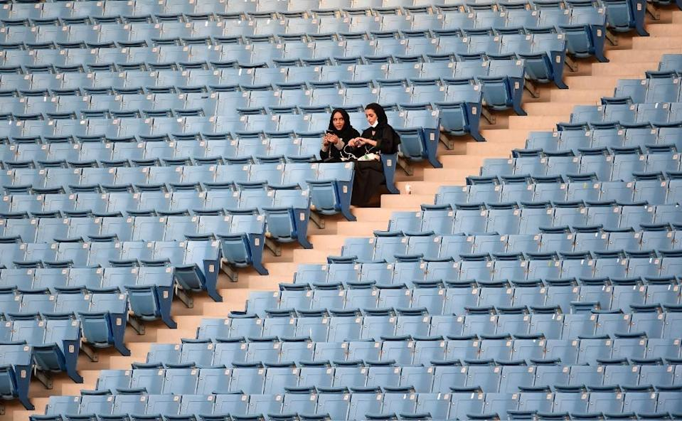 Saudi women sit in a Riyadh stadium for the first time to attend Saudi national day on September 23, 2017 (AFP Photo/Fayez Nureldine)