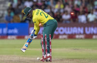 South Africa's batsman Andile Phehlukwayo is bowled by England's bowler Chris Jordan for duck during the 2nd T20 cricket match between South Africa and England at Kingsmead stadium in Durban, South Africa, Friday, Feb. 14, 2020. (AP Photo/Themba Hadebe)