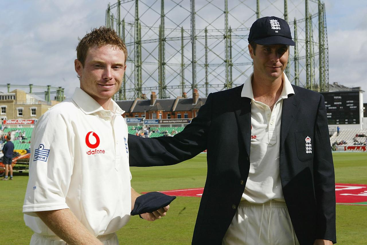 LONDON - AUGUST 19:  Ian Bell of England recieves his cap from Michael Vaughan of England prior to the 4th npower test match between England and the West Indies at the Oval on August 19 2004 in London, England. (Photo by Tom Shaw/Getty Images) *** Local Caption *** Ian Bell; Michael Vaughan