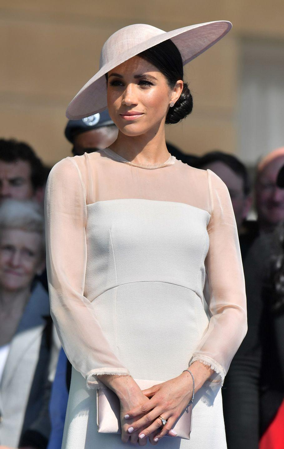 <p>For a celebration at Buckingham Palace, Meghan decked herself out in a monochrome set of pale neutrals. <br></p>