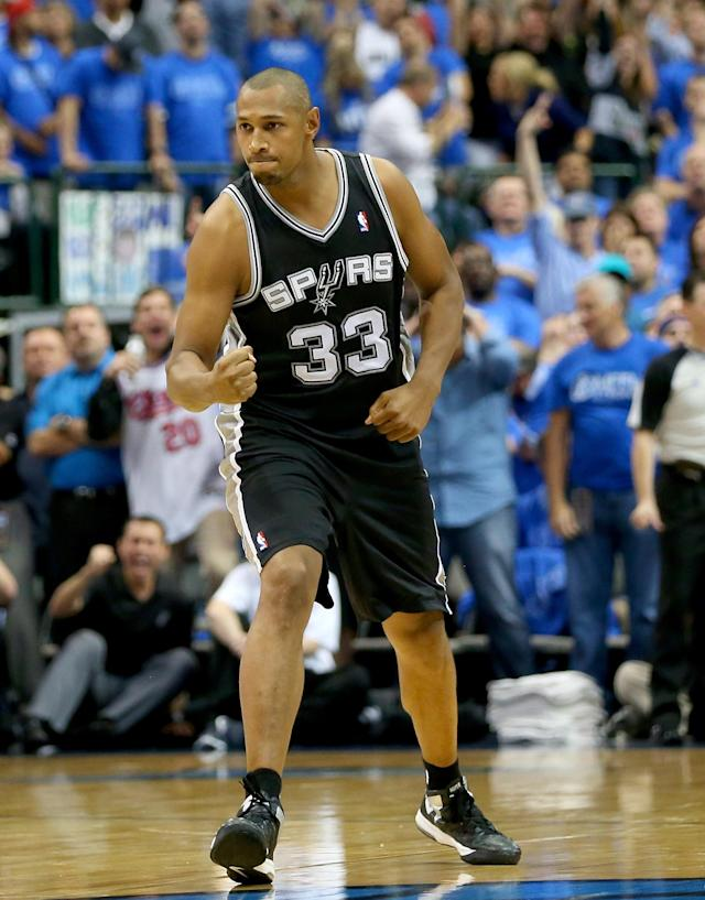DALLAS, TX - APRIL 28: Boris Diaw #33 of the San Antonio Spurs reacts after making a three point shot against the Dallas Mavericks in Game Four of the Western Conference Quarterfinals during the 2014 NBA Playoffs at American Airlines Center on April 28, 2014 in Dallas, Texas. (Photo by Ronald Martinez/Getty Images)