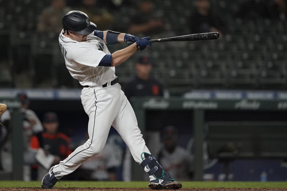 Seattle Mariners' Tom Murphy hits a solo home run during the eighth inning of a baseball game against the Detroit Tigers, Monday, May 17, 2021, in Seattle. (AP Photo/Ted S. Warren)