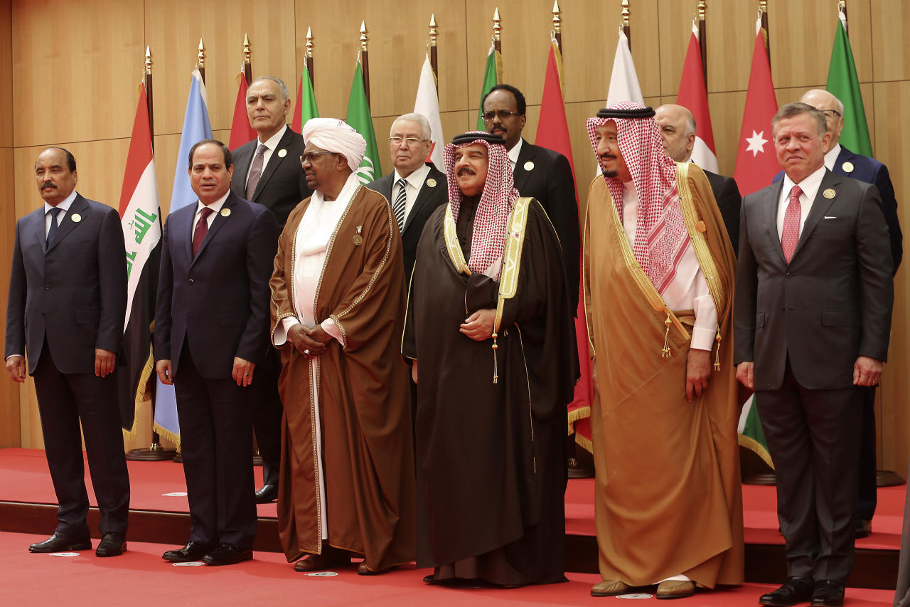 <p> A section of twenty one kings, presidents and top officials from the Arab League summit pose for a group photo, at a gathering near the Dead Sea in Jordan on Wednesday, March 29, 2017. With the exception of Syria, whose chair sits empty, all Arab states are participating in the annual event aiming to work on regional solutions to conflicts in Yemen, Libya, Iraq and Syria while tackling extremism, poverty and worries over the new American administration. (AP Photo/ Raad Adayleh) </p>