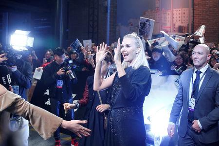 """Actor Charlize Theron reacts on the red carpet at a media event for the new film """"The Fate of the Furious"""" in Beijing"""