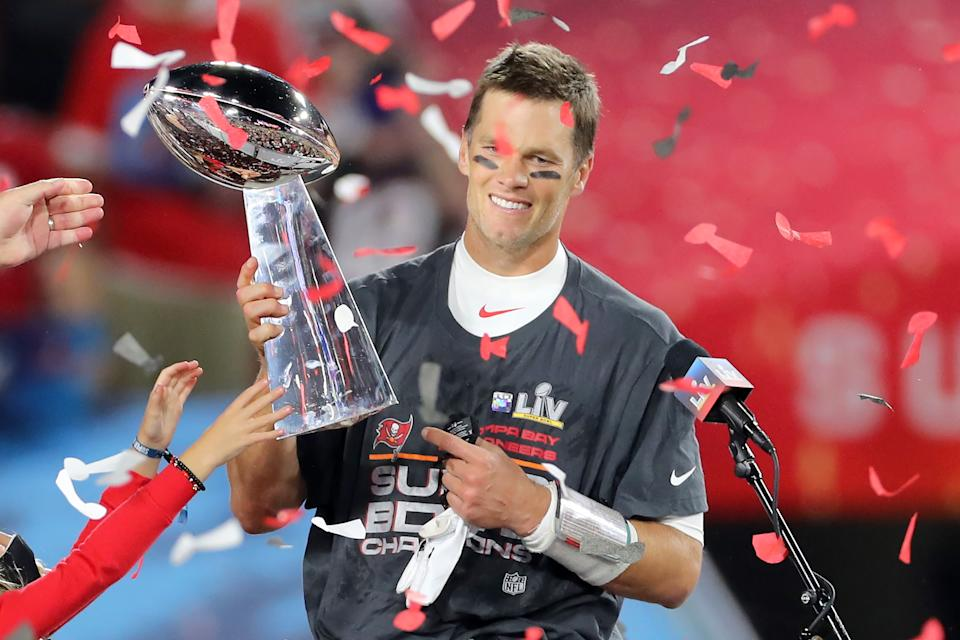 TAMPA, FL - FEBRUARY 07: Super Bowl MVP Tom Brady (12) of the Buccaneers holds the Lombardi Trophy after the Super Bowl LV game between the Kansas City Chiefs and the Tampa Bay Buccaneers on February 7, 2021 at Raymond James Stadium, in Tampa, FL. (Photo by Cliff Welch/Icon Sportswire via Getty Images)