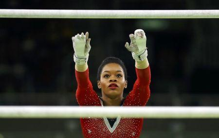 FILE PHOTO: 2016 Rio Olympics - Artistic Gymnastics - Final - Women's Uneven Bars Final - Rio Olympic Arena - Rio de Janeiro, Brazil - 14/08/2016. Gabrielle Douglas (USA) of USA (Gabby Douglas) competes. REUTERS/Mike Blake/File Photo