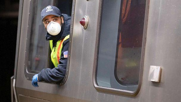 PHOTO: A subway train driver wearing a protective mask operates the doors of a Massachusetts Bay Transportation Authority's Blue Line subway car at Maverick Station in Boston, April 24, 2020. (Michael Dwyer/AP, FILE)