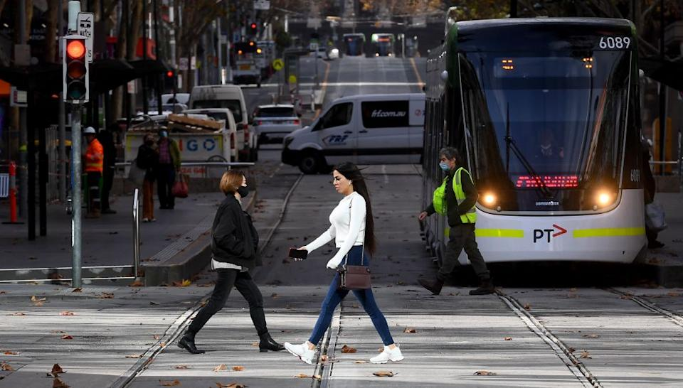 People cross Melbourne's normally bustling Bourke Street Mall on June 4, 2021, as the coronavirus lockdown of Australia's second-biggest city is extended by another seven days, authorities announced. (Photo by William WEST / AFP) (Photo by WILLIAM WEST/AFP via Getty Images)