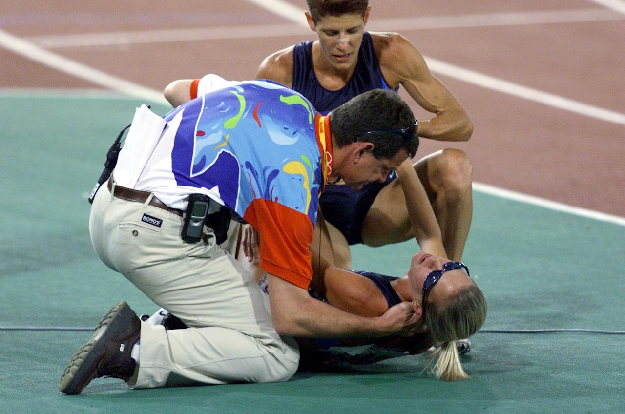 30 Sep 2000: Suzy Favor Hamilton of the USA is attended to by a doctor and team mate Marla Runyan after a fall, in the final of the Women's 1500m at the Sydney 2000 Olympic Games, held at Stadium Australia, Homebush Bay in Sydney, Australia. DIGITAL IMAGE Mandatory Credit: Sean Garnsworthy/ALLSPORT