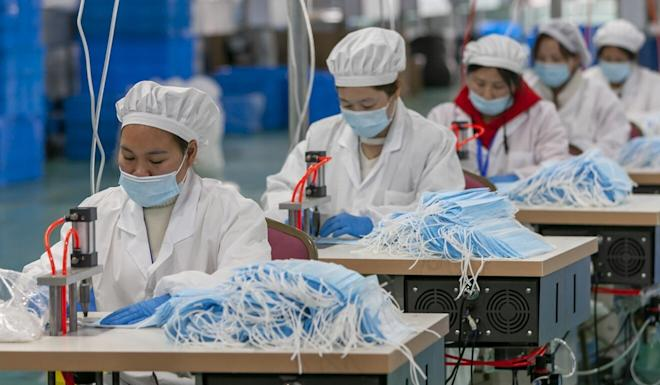 Workers make protective masks at a factory in Shanghai. Beijing's diplomats have touted China's donations of PPE and its containment of the virus. Photo: Xinhua