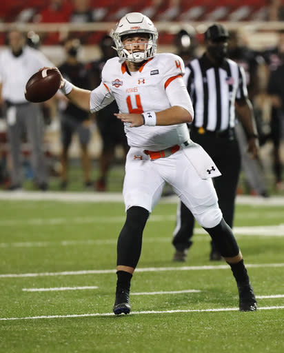 Houston Baptist quarterback Bailey Zappe looks for a receiver during the second half of the team's NCAA college football game against Texas Tech on Saturday, Sept. 12, 2020, in Lubbock, Texas. (AP Photo/Mark Rogers)