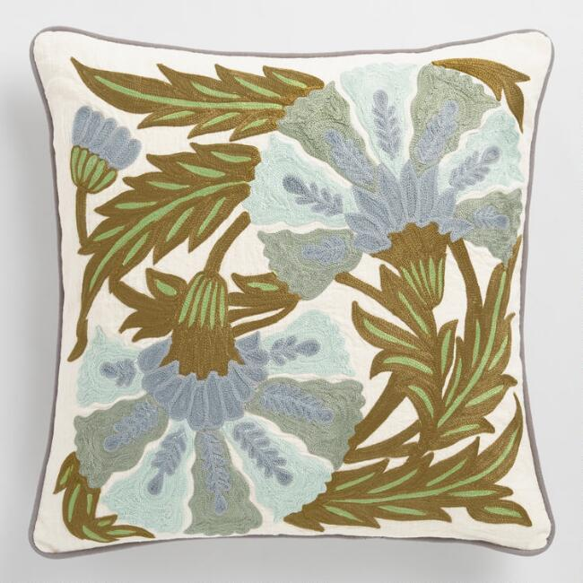 """<strong>Style Says: """"My Nana Hand-Embroidered This""""</strong><br>No one needs to know your Nana prefers being out on the town to needlework, let alone even try to create this beautiful crewel-embroidered blossom throw pillow...<br><br><strong>Cost Plus World Market</strong> Floral Embroidered Throw Pillow, $, available at <a href=""""https://go.skimresources.com/?id=30283X879131&url=https%3A%2F%2Fwww.worldmarket.com%2Fproduct%2Folive-and-blue-floral-embroidered-throw-pillow.do"""" rel=""""nofollow noopener"""" target=""""_blank"""" data-ylk=""""slk:Cost Plus World Market"""" class=""""link rapid-noclick-resp"""">Cost Plus World Market</a>"""