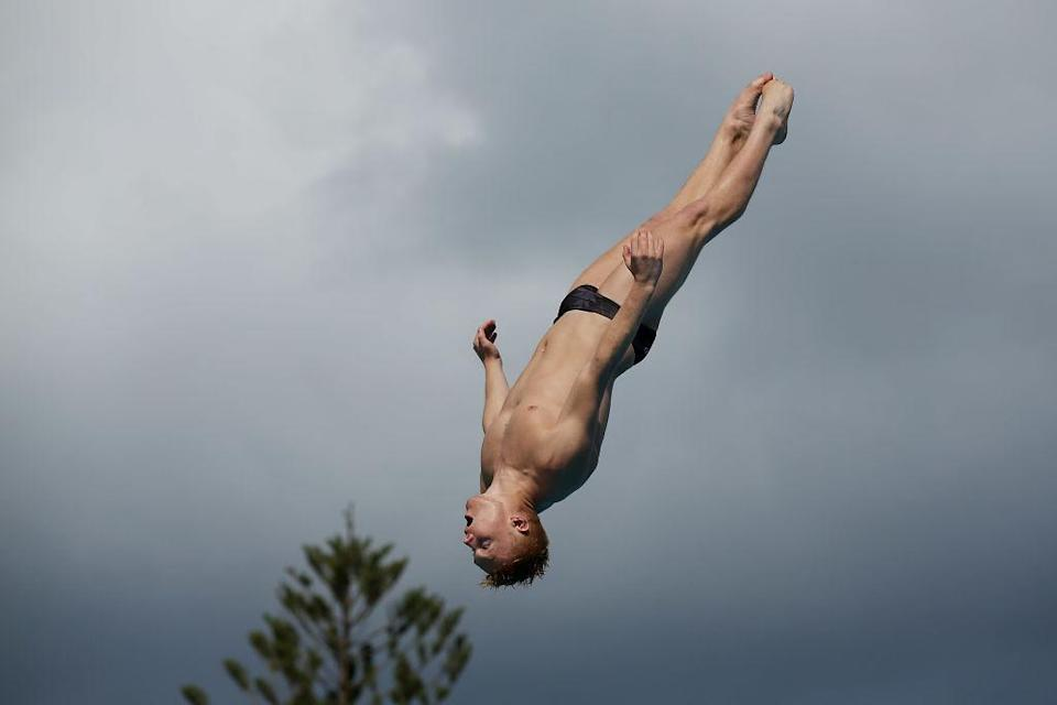 <p>Liam Stone of New Zealand dives in the Men's 3m springboard semi final during the FINA Gold Coast Diving Grand Prix at the Gold Coast Aquatic Centre in Gold Coast, Australia. (Chris Hyde/Getty Images) </p>