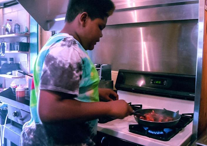 MasterChef Junior contestant Ben Watkins cooks at his family's restaurant Big Ben's Bodacious BBQ. (The Times of Northwest Indiana)