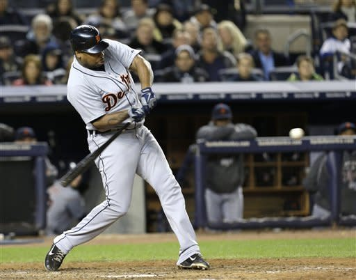 Detroit Tigers' Delmon Young hits a solo home run in the eighth inning during Game 1 of the American League championship series against the New York Yankees Saturday, Oct. 13, 2012, in New York. (AP Photo/Paul Sancya )