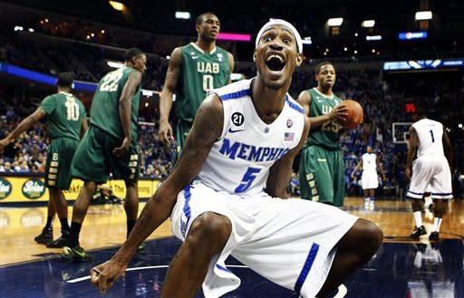 Memphis' Will Barton (5) celebrates after a dunk against UAB during the first half of an NCAA college basketball game, Saturday, Feb. 11, 2012, in Memphis, Tenn. (AP Photo/The Commercial Appeal, Mark Weber)
