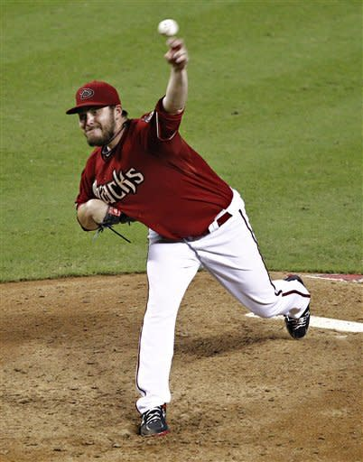 Arizona Diamondbacks' Wade Miley delivers a pitch to the Miami Marlins during the eighth inning of a baseball game, the second game of a doubleheader, Wednesday, Aug. 22, 2012, in Phoenix. (AP Photo/Matt York)