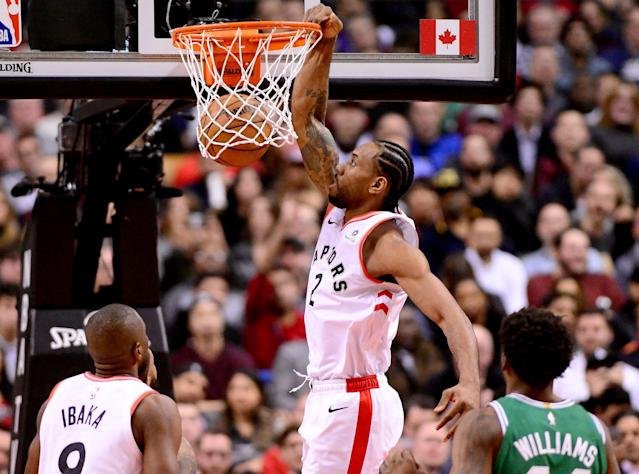 Kawhi Leonard dunks the ball during first half Tuesday night against the Boston Celtics in Toronto. (Frank Gunn/The Canadian Press via AP)
