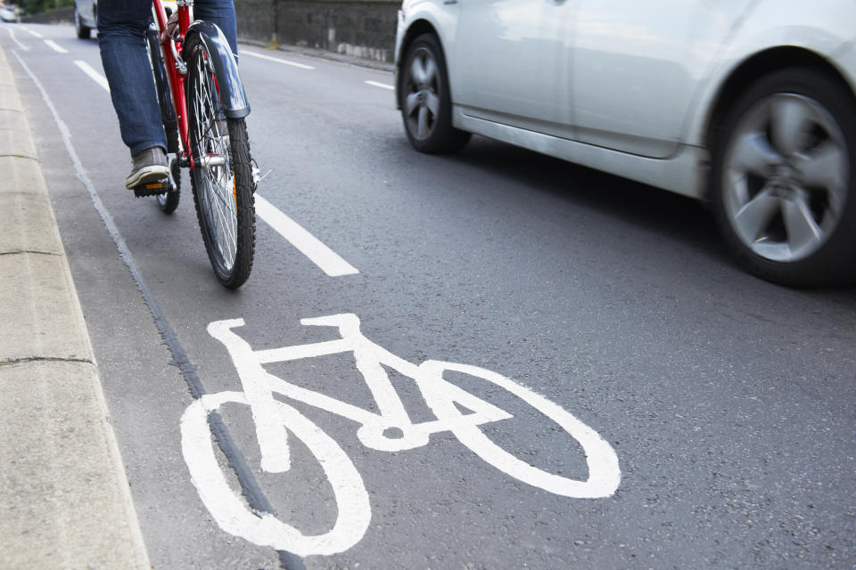 A cyclist riding next to car. Source: Getty Images