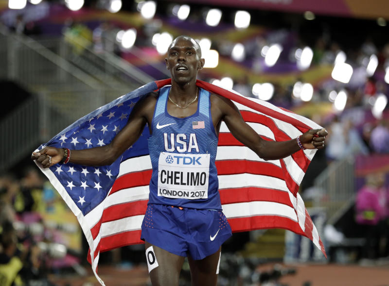United States' Paul Kipkemoi Chelimo celebrates after winning the bronze medal in the men's 5000-meter final during the World Athletics Championships in London Saturday, Aug. 12, 2017. (AP Photo/Matthias Schrader)