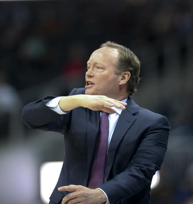 Atlanta Hawks head coach Mike Budenholzer positions his players during the first half of an NBA basketball game against the Sacramento Kings Wednesday, Nov. 15, 2017, in Atlanta. (AP Photo/John Bazemore)