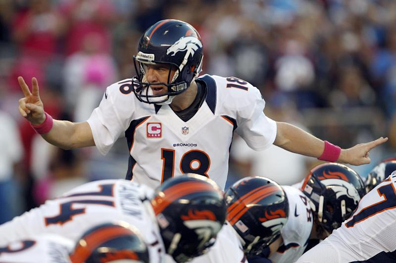 Denver Broncos quarterback Peyton Manning motions to teammates during the first half of an NFL football game against the San Diego Chargers, Monday, Oct. 15, 2012, in San Diego. (AP Photo/Lenny Ignelzi )