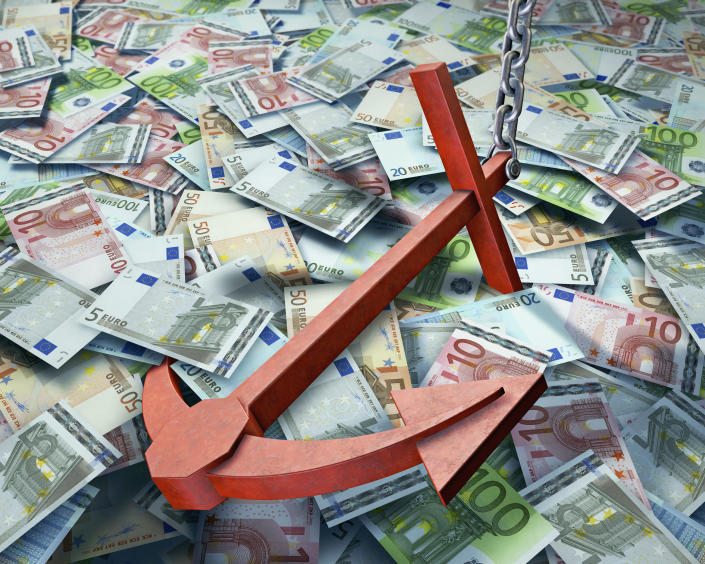 Image of a red anchor resting on pile of money.