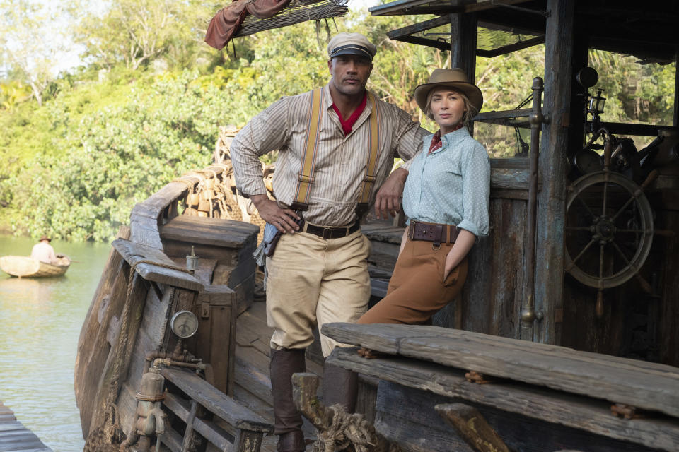 """This image released by Disney shows Dwayne Johnson, left, and Emily Blunt in """"Jungle Cruise."""" (Frank Masi/Disney via AP)"""