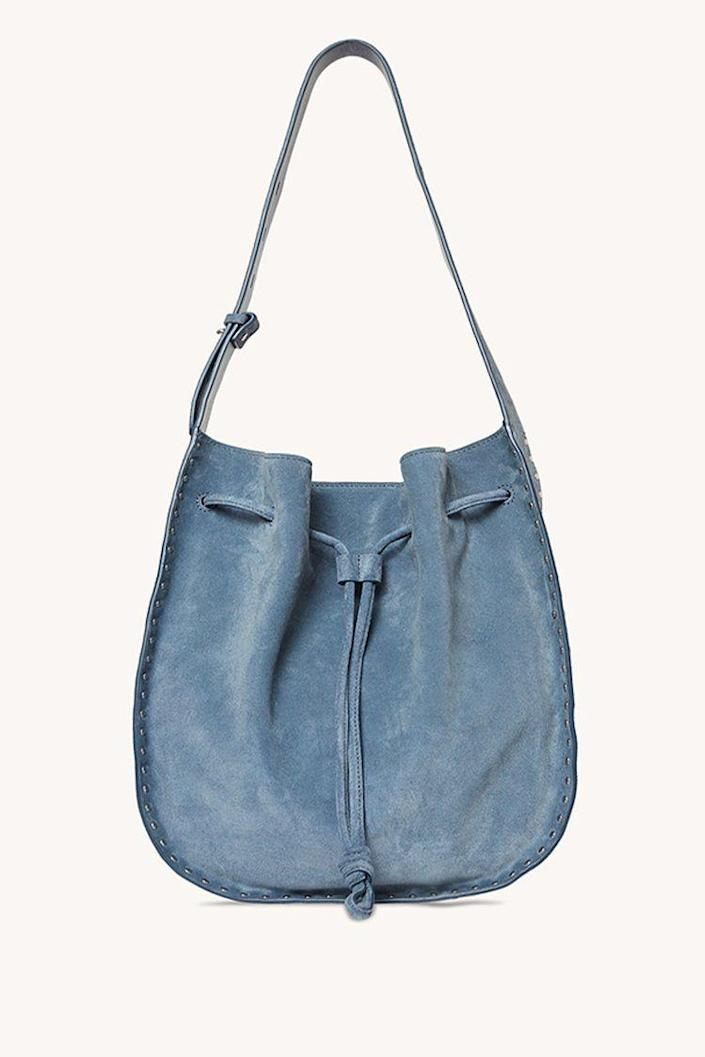 """<p><strong>Rebecca-Minkoff</strong></p><p>rebeccaminkoff.com</p><p><strong>$298.00</strong></p><p><a href=""""https://go.redirectingat.com?id=74968X1596630&url=https%3A%2F%2Fwww.rebeccaminkoff.com%2Fproducts%2Fnanine-drawstring-shoulder-bag-xs21ened64-luna&sref=https%3A%2F%2Fwww.cosmopolitan.com%2Fstyle-beauty%2Ffashion%2Fg35681726%2Fexpensive-items-on-sale-hauliday%2F"""" rel=""""nofollow noopener"""" target=""""_blank"""" data-ylk=""""slk:Shop Now"""" class=""""link rapid-noclick-resp"""">Shop Now</a></p>"""