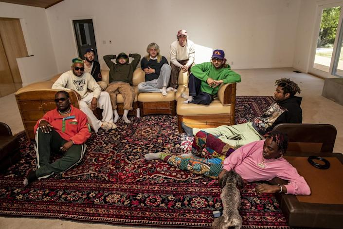 Brockhampton members sit around and relax.