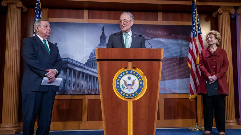 Senate Minority Leader Chuck Schumer (C) speaks as Democratic Senator from Illinois Dick Durbin (L) and Democratic Senator from Michigan Debbie Stabenow (R) keep their social distancing during a press conference at the US Capitol in Washington, DC, USA, 17 March 2020.