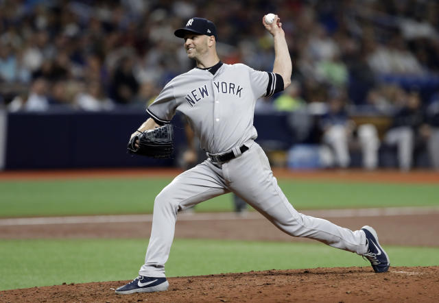 New York Yankees pitcher J.A. Happ delivers to a Tampa Bay Rays batter during the third inning of a baseball game Wednesday, Sept. 25, 2019, in St. Petersburg, Fla. (AP Photo/Chris O'Meara)