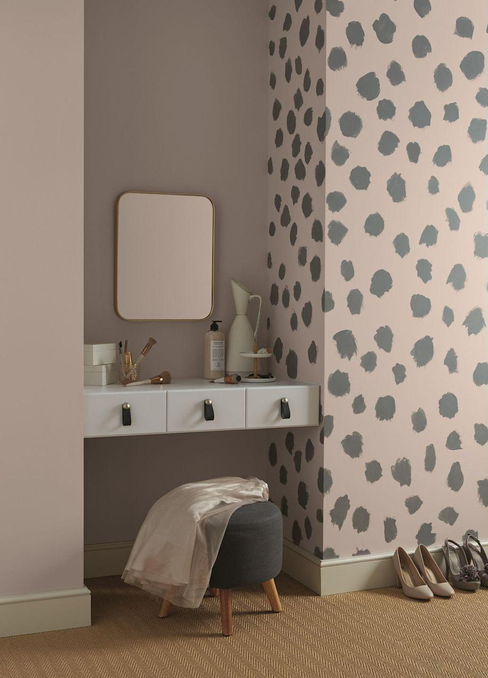 """<p>This is a great pink and grey bedroom idea, as it still looks stylish and doesn't overwhelm the space. In this predominantly pink room, splodges of dark grey have been painted onto the wall in a random pattern. It's easy to do and adds personality. Buy a grey stool to pull the scheme together.</p><p>Pictured: Hare (pink) and City Break (grey) matt emulsion, from <a href=""""https://www.crownpaints.co.uk/"""" rel=""""nofollow noopener"""" target=""""_blank"""" data-ylk=""""slk:Crown"""" class=""""link rapid-noclick-resp"""">Crown</a></p>"""