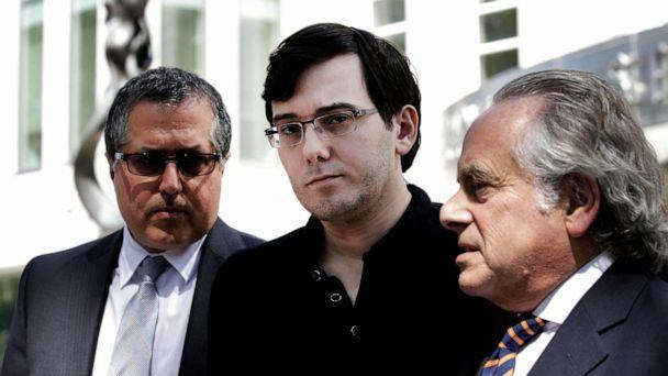 PHOTO: Martin Shkreli, former chief executive officer of Turing Pharmaceuticals AG, center, listens while his attorney Benjamin Brafman, right, speak to members of the media outside federal court in Brooklyn, N.Y., Aug. 4, 2017. (Peter Foley/Bloomberg via Getty Images)